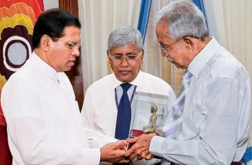 A brass replica of the Buddha Statue presented to President Maithripala Sirisena