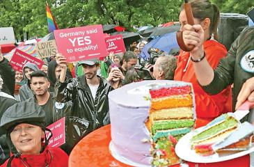Supporters of gay rights gathered outside the Chancellery cut a cake to celebrate a vote at the nearby Bundestag in which parliamentarians approved a new law legalizing gay marriage in Germany on June 30, 2017 in Berlin, Germany. In a historic vote following emotional statements by parliamentarians both for and against the issue Germany is transferring homosexual relationships from a privileged partnership to marriage with the same rights as marriage between heterosexual couples. (Getty Images)
