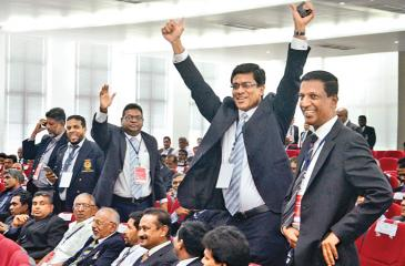 Anura de Silva gestures after being elected FFSL President