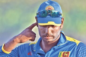 Sri Lankan cricket captain Angelo Mathew reacts their defeat on the first one-day international (ODI) cricket match between Sri Lanka and Zimbabwe at the Galle International Cricket Stadium in Galle on June 30, 2017. / AFP PHOTO / ISHARA S. KODIKARA