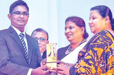 Representatives of Commercial Bank receiving the SLT ZeroOne Award for 'Best Website or Microsite – Finance Sector'