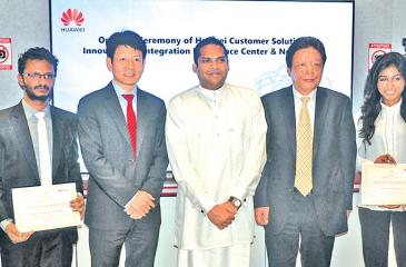 Minister of Telecommunication and Digital Infrastructure, Harin Fernando, Huawei Sri Lanka CEO, Shunli Wang, Economic and Commercial Counsellor of Chinese Embassy in Sri Lanka, Yang Zuoyuan with University students Yasiru Kassapa and Erandi Ganepola at the opening of the CSIC. Picture by Vipula Amerasinghe