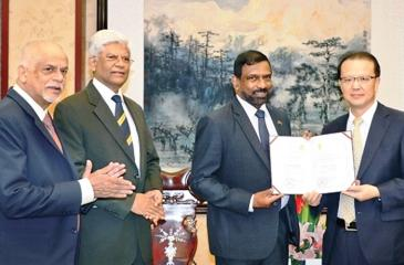 Admiral Dr. Jayanath Colombage receives the Guest Professorship from the Vice President of Sichuan University Professor of Economics Yan Shijing during a ceremony held in Chengdu, attended by Ambassador Bernard Goonethilleke, the Chairman and Luxman Siriwardene, Executive Director of Pathfinder Foundation.