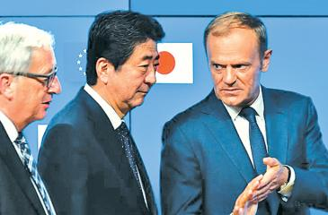 European Council President Donald Tusk, from right, Japanese Prime Minister Shinzo Abe and European Commission President Jean-Claude Juncker speak July 6 at a news conference. AFP/Getty Images