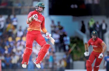 Zimbabwe's cricketer Craig Ervine celebrates after victory in the fourth one-day international (ODI) cricket match between Sri Lanka and Zimbabwe at the Suriyawewa Mahinda Rajapakse International Cricket Stadium - AFP