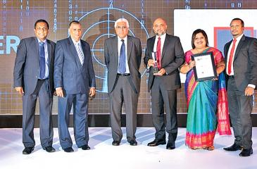 Director/CEO of LOLC Finance, Ashan Nissanka and Head of Liability Management, LOLC Finance, Roshani Weerasekera with the awards. Others from left: General Manager/CEO, LankaClear (Pvt) Ltd, Channa de Silva, Chairman, LankaClear (Pvt) Ltd., Anil Amarasuriya, Governor of the Central Bank, Dr. Indrajit Coomaraswamy and Head of Business Solutions, Banking, LOLC Technologies, Chinthaka Jayasinghe.