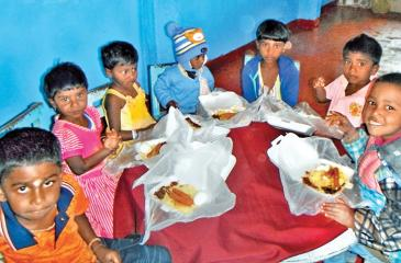 The children at the Crèches enjoying their special lunch