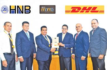 Chief Operating Officer, HNB, Dilshan Rodrigo exchanging the MOU with  Country Manager, DHL Keells, Dimithri Perera. (From left): Director Finance, DHL Keells, Anton Perera, Head of IT, DHL Keells, Vajira Bandara, Head of Cards, HNB, Roshantha Jayatunge and Executive, Card Acquisition, HNB, Samantha Jayatilake look on.