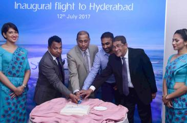 SriLankan Airlines, Director Harendra K. Balapatabendi with Chief Commercial Officer, Siva Ramachandran, Brand ambassador of SriLankan and former Sri Lanka cricket captain Mahela Jayewardene and SriLankan Airlines, Consultant Lal Perera cutting a cake minutes before the inaugural flight to Hyderabad.