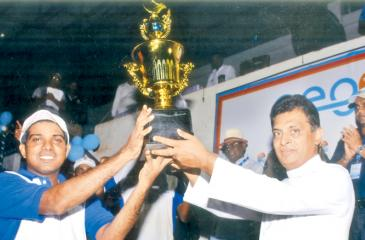 Sajith Kumara skipper of Camelot Beach Hotel receiving the champions Trophy  from chief guest Rev. Fr Jayantha Wicramasinghe.