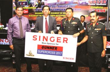 Director Marketing Singer Sri Lanka Kumar Samarasinghe handing over the main sponsorship cheque to Colonel Commandant of the Sri Lanka Artillery Regiment P.W.B. Jasundarara at press Briefing held at the Taj Samudra Hotel.   Picture by Rukmal Gamage.