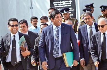 Minister Ravi Karunanayake at the PCoI premises.