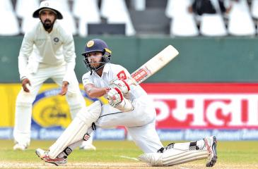 Kusal Mendis plays a shot during the third day of the second Test match – AFP