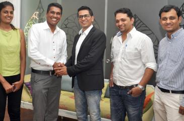 Apalya Technologies' Chief Operating Officer Venugopal Iyengar greets founder CEO of One Verge Holdings, Dilash Weerasooriya while Apalya's Head of Sales, Sarath Kumar, Head of Technology, Arun Kumar along with One Verge Key Account Manager, Kavindya de Silva look on.