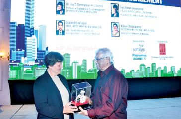 Dr. Surath Wickramasinghe presents a token of appreciation to Dr. Iris Tommelien.