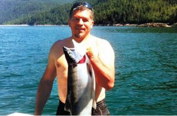 Denis Woodcox landed a record-breaking kokanee salmon on Lower Arrow Lake in 2015 but the previous record wasn't all he smoked; he also smoked the evidence before he ate it. (Noah Woodcox)