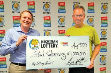 Paul Kuharevicz wound up purchasing a $1 million winning lottery ticket after his flight home from a business trip was cancelled. Pic: Michigan Lottery