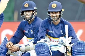 Angelo Mathews and Upul Tharanga await their batting turns during practice at the Rangiri Dambulla Stadium ahead of the first ODI against India on Sunday. – AFP