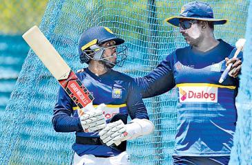 Kusal Mendis has a word with Sri Lanka one-day batting coach Avishka Gunawardene during net practice.  AFP