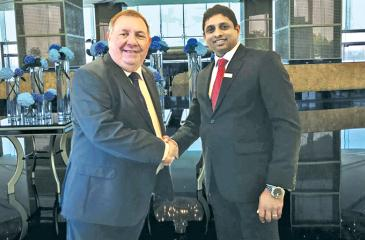 Chandrin Fernando with the President of CIMA  David Stanford