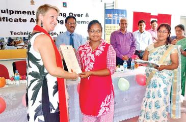 Miss Daniel Thas Nevis who completed the construction supervision course  receives the certificate from Ms. Soukupova.