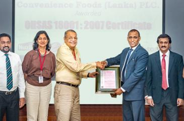 From left: Iranga Mahanama – Quality Assurance Manager, Convenience Foods, Asanka Kodithuwakku – Productivity Development Executive, Convenience Foods, Nandana Wickramage – Group Director Head of Marketing and Sales, Ceylon Biscuits Limited, Sheamalee Wickramasingha,  Group Managing Director, Ceylon Biscuits Limited, R. S. Wickramasingha,  Group Chairman, Ceylon Biscuits Limited, Pradeep Gunawardana – Chairman, Sri Lanka Standards Institution, T.G.G. Dharmawardane - Director General, Sri Lanka Standards Ins