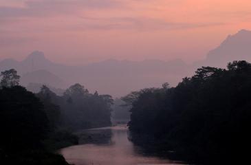A breathtaking view of sunrise at the dawn over Yatiyantota mountain ranges, seen through the valley of Kelani Ganga at Karawanella.