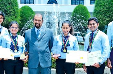 The winning IHS students with Principal Ravindra Magedera
