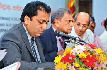 Education Minister Akila Viraj Kariyawasam and Sri Lanka Insurance Chairman Hemaka Amarasuriya at the media briefing.