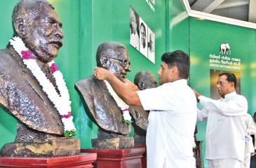 Senior UNP members pay homage to the party leaders at Sirikotha at an event to mark the anniversary on September 6 Pic: Shan Rambukkwella