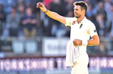 England's James Anderson holds the ball that took his 500th Test match wicket, West Indies' Kraigg Brathwaite for 4 runs, during the second day of the third international Test match between England and West Indies at Lords on September 8. AFP