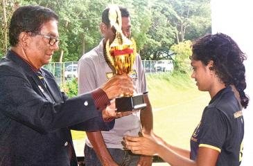 Manager of the Palinks Cricket team, Palitha Gunasekera awarding the Runners-up trophy to Udara Bandara Captain of Mahamaya Girls College.
