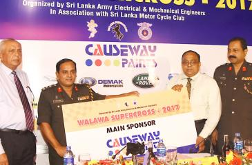General Manager of Causeway Paints Ltd. V Kiritharan hands over the sponsorship cheque for the Walawa Supercross -2017 to Col. Commmadant Brigadier Duminda Sirinaga of SLEME. Also in the picture are Ananda Jayasekera, President SLMCC and Center Commadant of SLEME Saman Fonseka. Picture by Rukmal Gamage