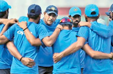 Galle :  Indian cricket team coach Ravi Shastri, center facing camera, speaks to players before the beginning of the fourth day of the first test cricket match between India and Sri Lanka in Galle, Sri Lanka, Saturday, July 29, 2017.