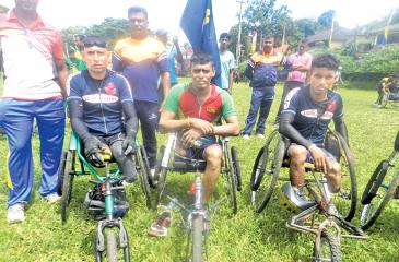 Wheelchair marathon winners after receiving their Awards R.D.A. Somasiri  (center) and runners up, A.H.M. Abeyratne and H.M. Premachandra of Light  Infantry Regiment.
