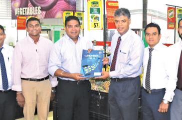Mobitel, Chief Executive Officer Nalin Perera exchanges the agreement with Jaykay Marketing Services,  Chief Executive Officer Charitha Subasinghe. Looking on (from left) are - Mobitel, Manager Mobile Financial Services, Padmanath Muthukumarana, Mobitel, Head of Mobile Financial Services, Kalhara Gamage, Mobitel, Senior General Manager Marketing, Isuru Dissanayaka, Jaykay Marketing Services Head of IT, Osanda Warnakulasuriya,  Jaykay Marketing Services, Manager, Finance, Eranga Illangasinghe and Mobitel, As