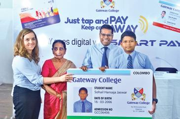 From left: Deputy Principal, Gateway College Colombo, Mrs Marzena Brzezniak, Managing Director, Gateway, Mrs Rohini Alles and Chief Operating Officer, Hatton National Bank, Dilshan Rodrigo present the HNB Smart Pay card to Gateway College student Sohail Hansaja Jaswar.