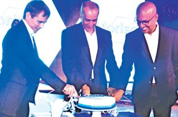 Managing Director, Hemas Holdings, Steven Enderby, Husein Esufally and Trihan Perera cut the cake. PICTUREs: Vipula amarasinghe