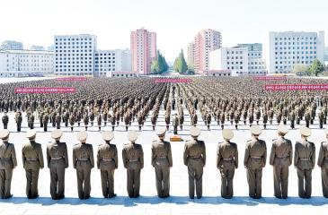 Military personnel take part in an anti-US rally in Pyongyang, North Korea.   Pic: STR/AFP/Getty Images
