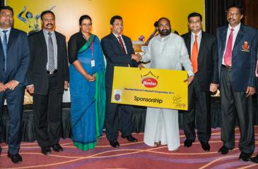 Nalin  .B. Karunaratne , Chief  Executive  Officer of  Ceylon Biscuits  Limited  presenting  the  sponsorship  cheque  in connection with  Munchee  National  Volleyball  Championship  to  Minister  Ranjith   Siyambalapitiya ,President  of  Sri Lanka  Volleyball  Federation. Also  in the  picture  are  (R-L)  Romesh  Jayathillake, Asst.Marketing  Manager-Munchee) , Janaka Boteju (Manager  Public  Relations of  CBL ) ,Ms.Surani Sahabandu(General Manager  Marketing  of  CBL  )  Kanchana Jayaratne (Vise Preside