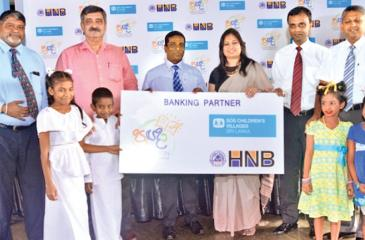 HNB officials present the sponsorship to the SOS Children's Village
