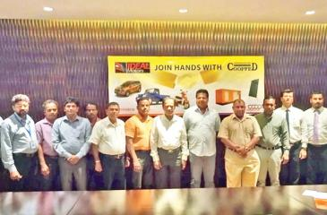 Chairman, Ideal Motors, Nalin Welgama and Deputy Chairman Aravinda de Silva with members of COOPFED