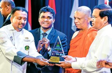 Chef Dimuthu receiving his award from President Maithripala Sirisena.