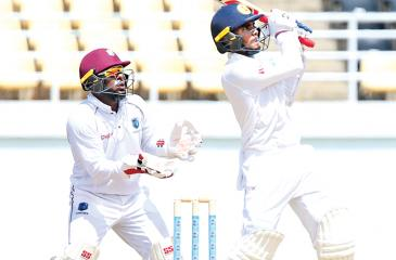 Sri Lanka A captain Dhananjaya de Silva pulls on the leg side watched by  West Indies 'A' wicket-keeper John Hamilton during his innings of 104 on  the third day of the first unofficial test at Jamaica.