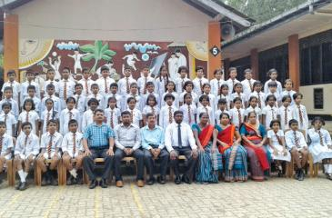 The 56 students of Ovitigama Primary School, Pugoda who were successful in the  Grade 5 Scholarship Examination with their teachers.