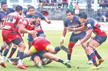 Pic: Malan Karunaratne An exciting moment in yesterday's  opening game of  the Dialog Inter Club Rugby League match  between Kandy SC and CH&FC played  at  the Race Course grounds.