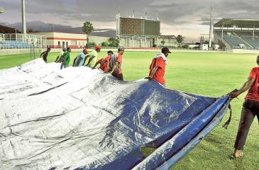 Ground staff pull the covers on at Sabin Park, Kingston, Jamaica where the second unofficial ODI between Sri Lanka A and West Indies A was abandoned without a ball bowled.