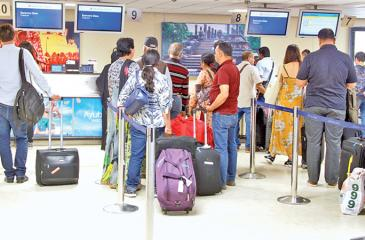 Passengers waiting to board the flight   Pix: Kalum Liyanage