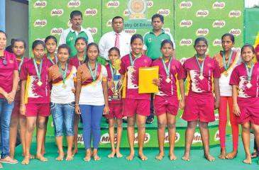 UNDER 14 - Ginthota Vidyalaya under 14 Girls team which won the championship pose for photo with chief guest Senior Manager – Activation and Sponsorships Nestle Lanka Ltd. Sajeewa Wickramasinghe.