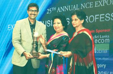 99X Technology Manager - Business Consulting Prasath Mahalingam (left) accepting the Gold Award for the Export of Business and Professional  Services